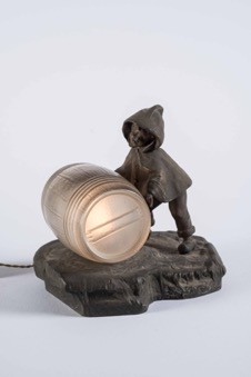 Bronze and Glass Light-up Figurine of a Boy Rolling Barrel