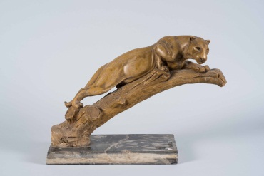 Carved Stone of a Resting Puma on Marble Base