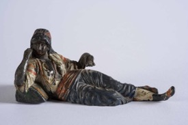 A Cold Painted Bronze Figure of a Sleeping Woman