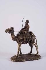 Bronze Statue of an Arab Bedouin Riding Camel