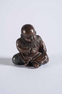 Oriental Bronze Figurine of a Seated Child