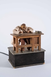 Figurine of a Clockmaker at Work