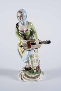 Continental Porcelain Figurine of a Woman Playing Instrument