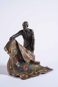 "Very fine Orientalist bronze sculpture after Franz Bergman, ""Le Marchande de Tapis"" (The Carpet Dealer)"