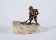 Small Bronze Sculpture of a Child Shoveling Snow on Stone Base